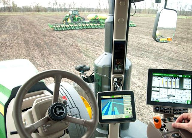 View From The Inside Of A John Deere Tractor Cab With