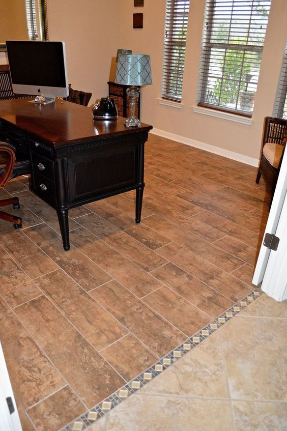 Replace Carpet With Tile That Looks Like Wood Planks We Used A Decorative Border To Transition From One The Next So Easy Clean