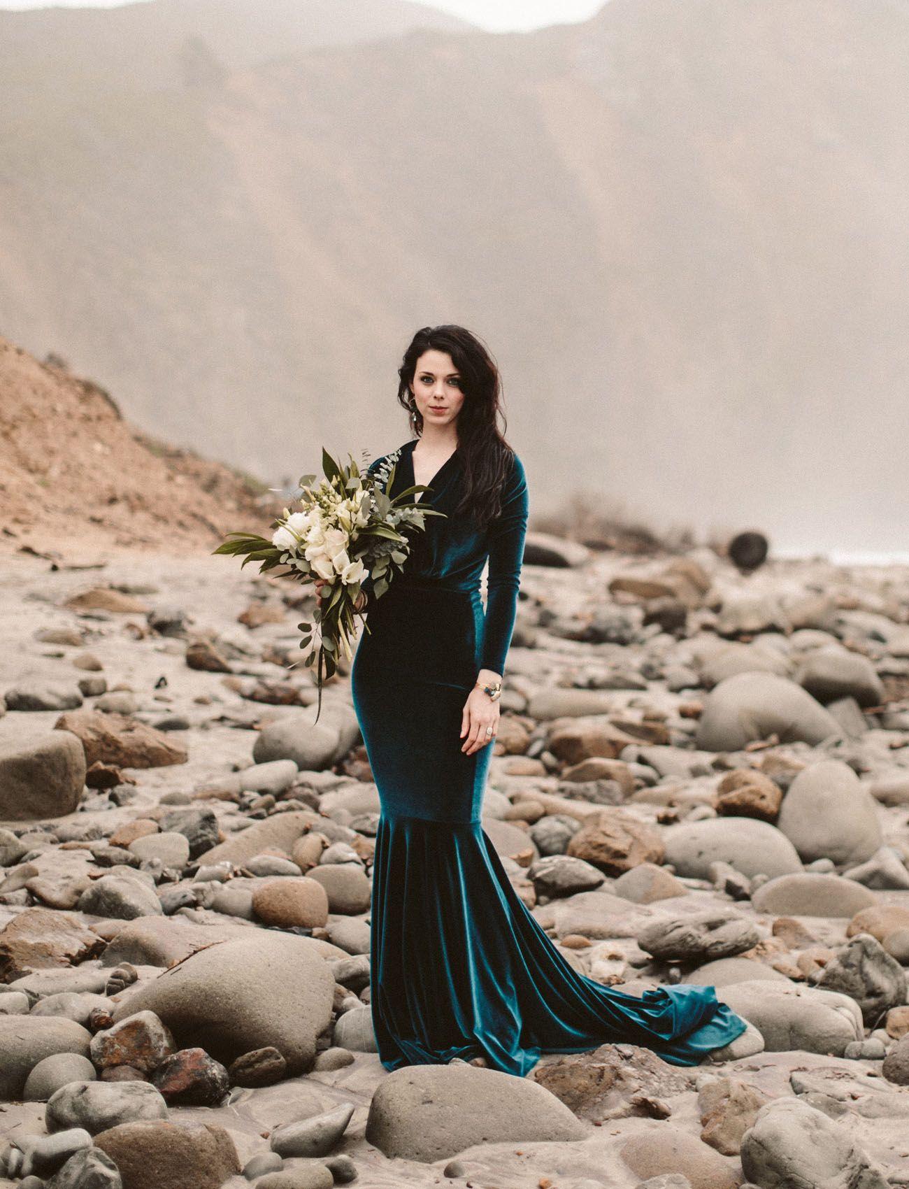 The bride wore a teal velvet wedding dress in this big sur elopement