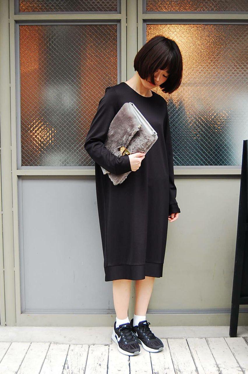 A Sack Like Sweatshirt Dress And Sneakers Minimalist