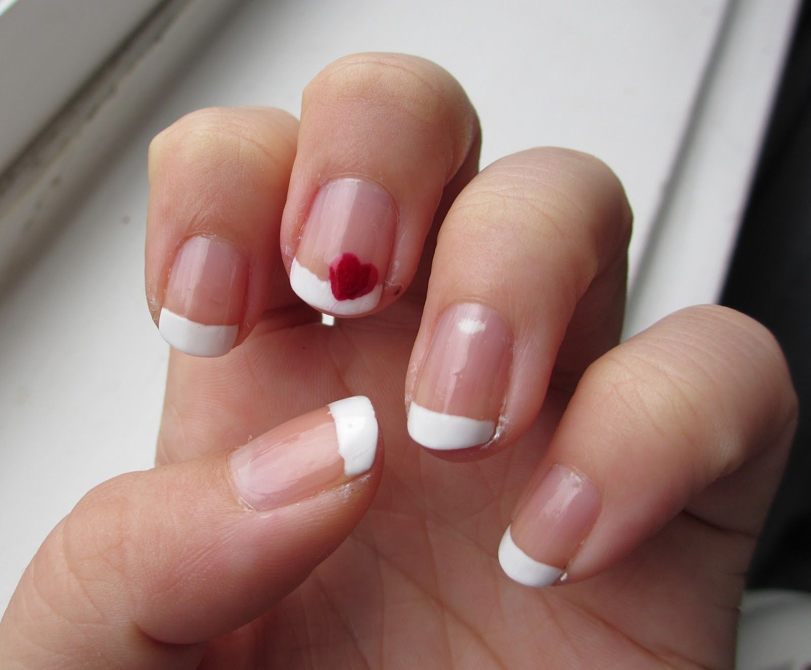 french manicure with red heart