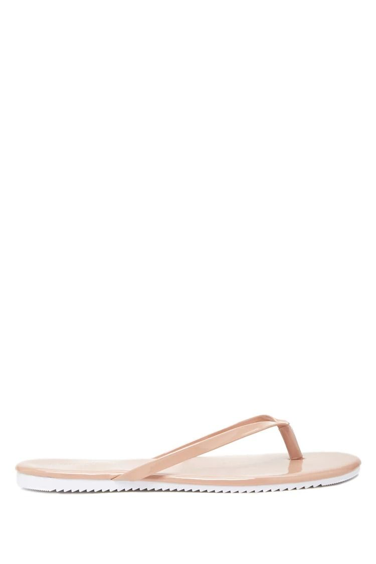 7ab461962 A pair of faux patent leather thong sandals.