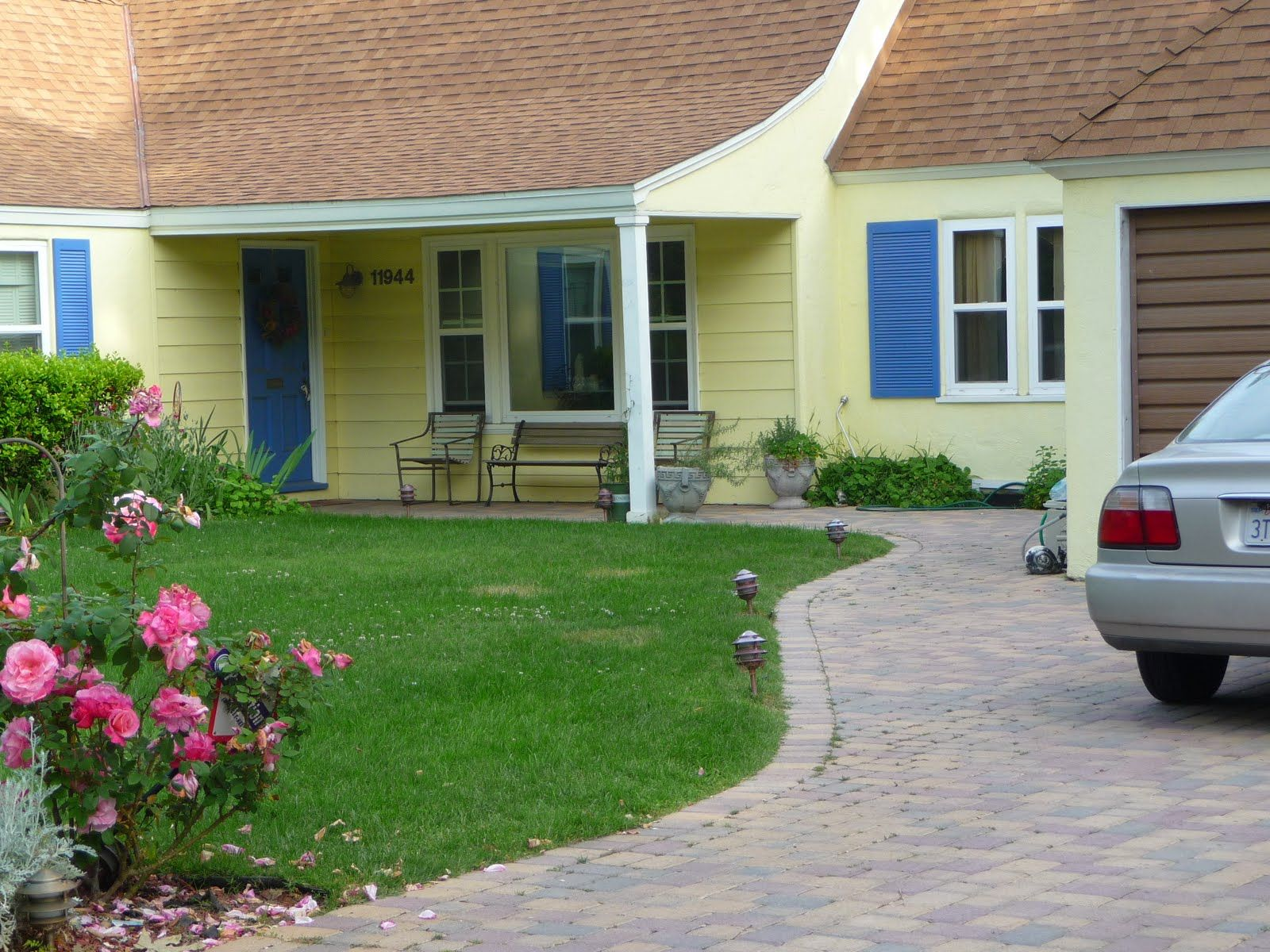 Preferred Yellow House With Blue Shutters Red Roof Green House Exterior Yellow House Exterior Blue Shutters
