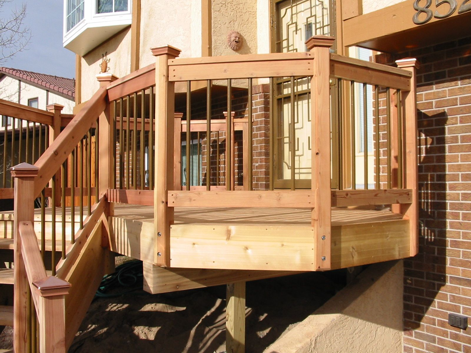 Enchanting rod iron fence with chic ornament for outdoor design appealing deck railing with wooden