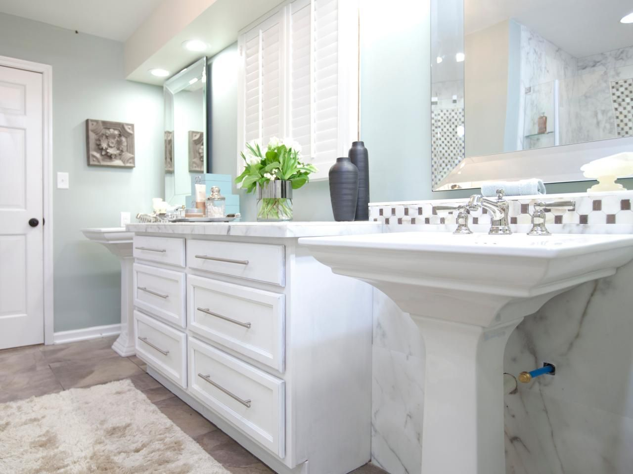 This Contemporary Bathroom Features Subtle Mint Green Walls Paired With White Cabinetry And A Carrara