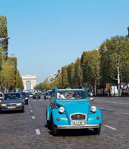 blue citro n 2cv on the champs elysees paris france. Black Bedroom Furniture Sets. Home Design Ideas