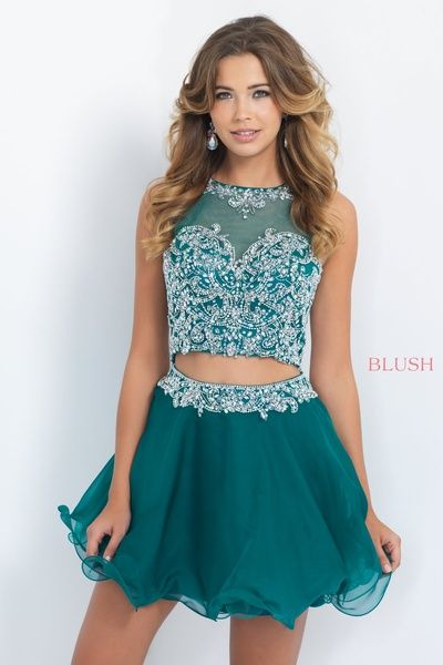 Vine like pattern of AB stones and crystals sparkle and cover the entire bodice of this short sleeve chiffon two piece that features a bateau neckline, keyhole back, and waist trimmed in the same pattern of beading. Back zipper closure. Available in Evergreen and Bright Navy.