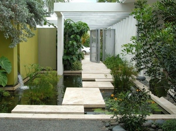 Modern pond with large tiles as road