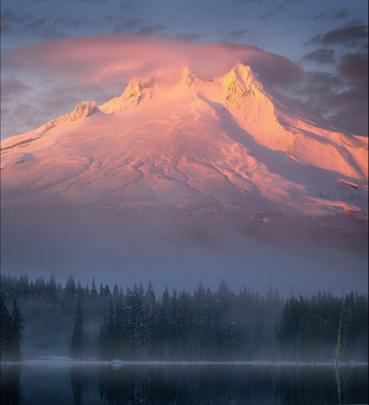 Mt Hood looking quite majestic as the sunsets over a half way frozen Trilliun Lake  US