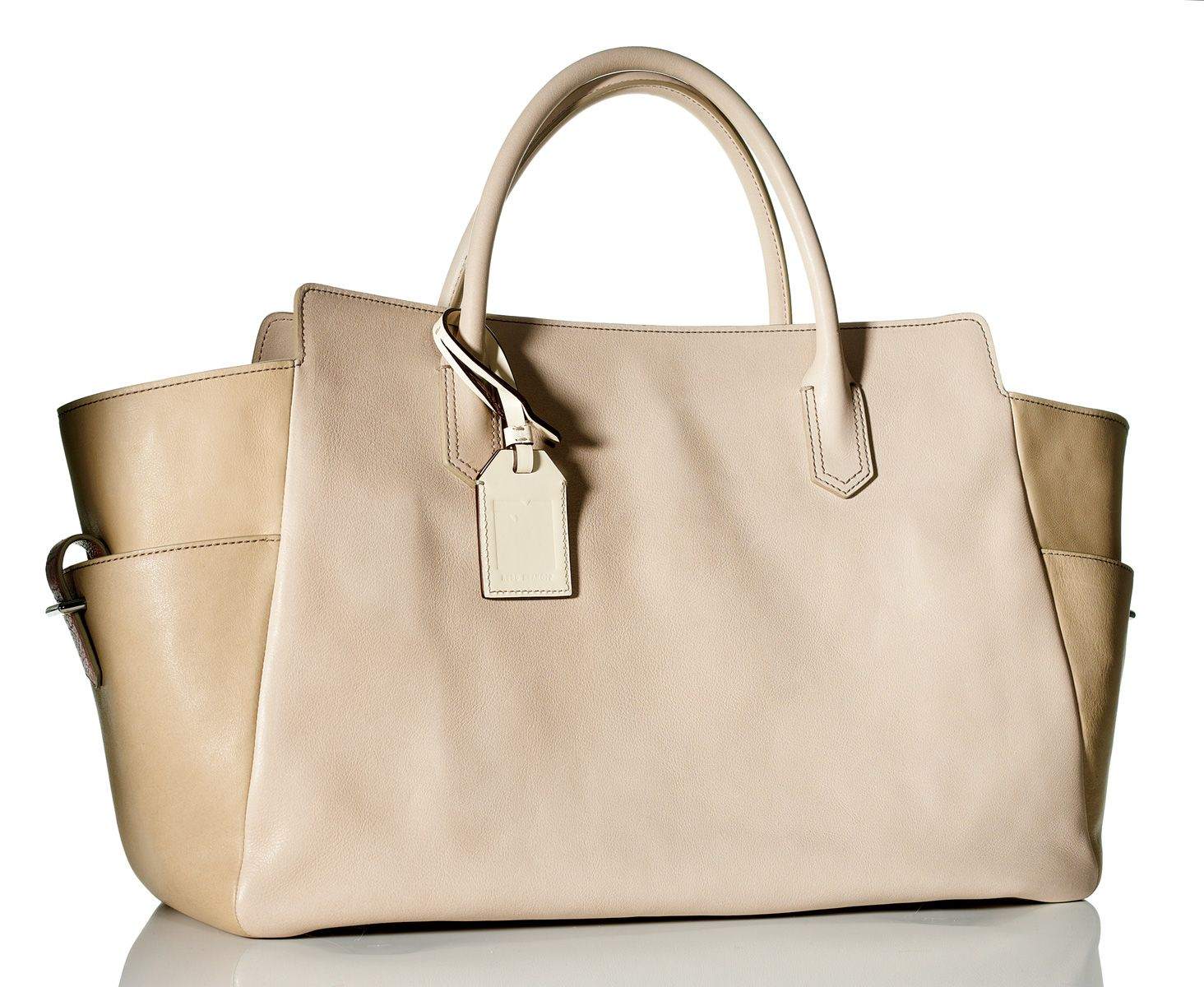 """""""I'm drawn to the unadorned simplicity of this Reed Krakoff bag. It's functional, ideal for flying, and classically chic."""" Bag; (877) 733-3525. - Photo: Liam Goodman"""