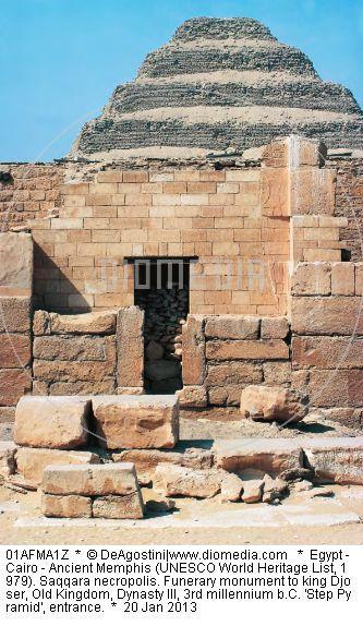Egypt - Cairo - Ancient Memphis (UNESCO World Heritage List, 1979). Saqqara necropolis. Funerary monument to king Djoser, Old Kingdom, Dynasty III, 3rd millennium b.C. 'Step Pyramid', entrance.