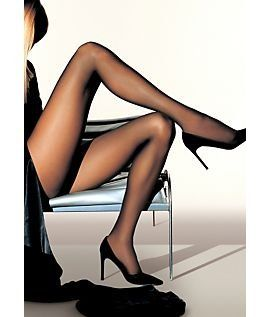 The leg in sheer black hosiery is as timeless, classic, elegant and powerful as a Porsche 911. Shown: Wolford Individual 10 pantyhose