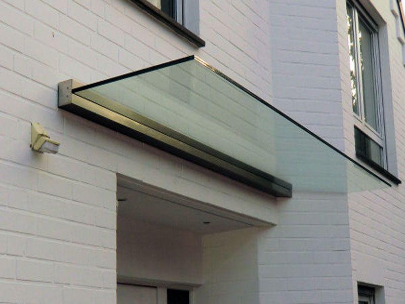 edelstahlvordach paderborn ein echtglas haust rvordach wo das glas von einer wandklemmleiste. Black Bedroom Furniture Sets. Home Design Ideas