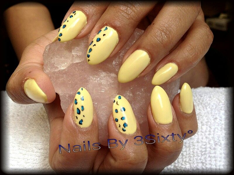 Almond shaped gel nails. Yellow gel paint with blue and black ...