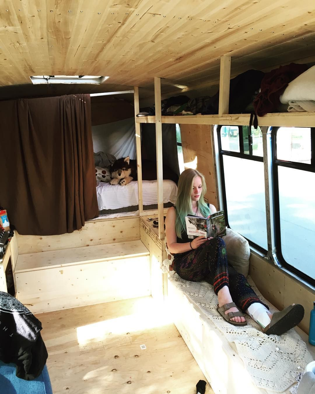 We still have a long way to go! But with our makeshift curtains and sheet wall the added storage and the adjustment to life on the bus it is beginning to feel more and more like home.  Brianna is is trying to keep the stoke high in her downtime by reading the new Vancouver Climbing guidebook by @richwheaterphoto  #adventure #buslife by oneloveonebus