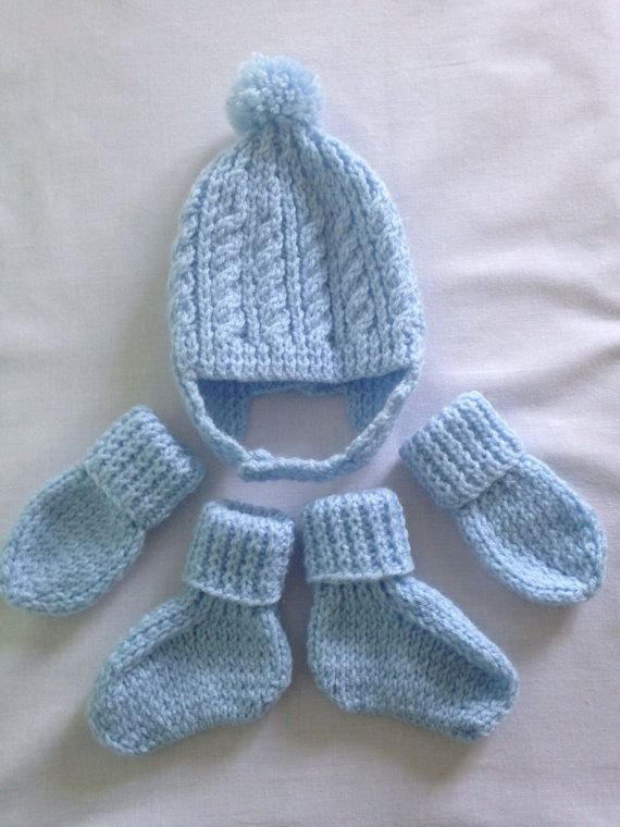 hand knitted baby boys blue cable and rib helmet hat