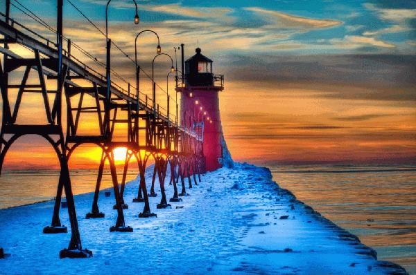 """South Haven Pier. Photo Credit: Craig Gardiner. This image is what is called a """"high dynamic range"""" photo. It is a combo of 3 or 5 exposures of the same scene to achieve a painterly look."""