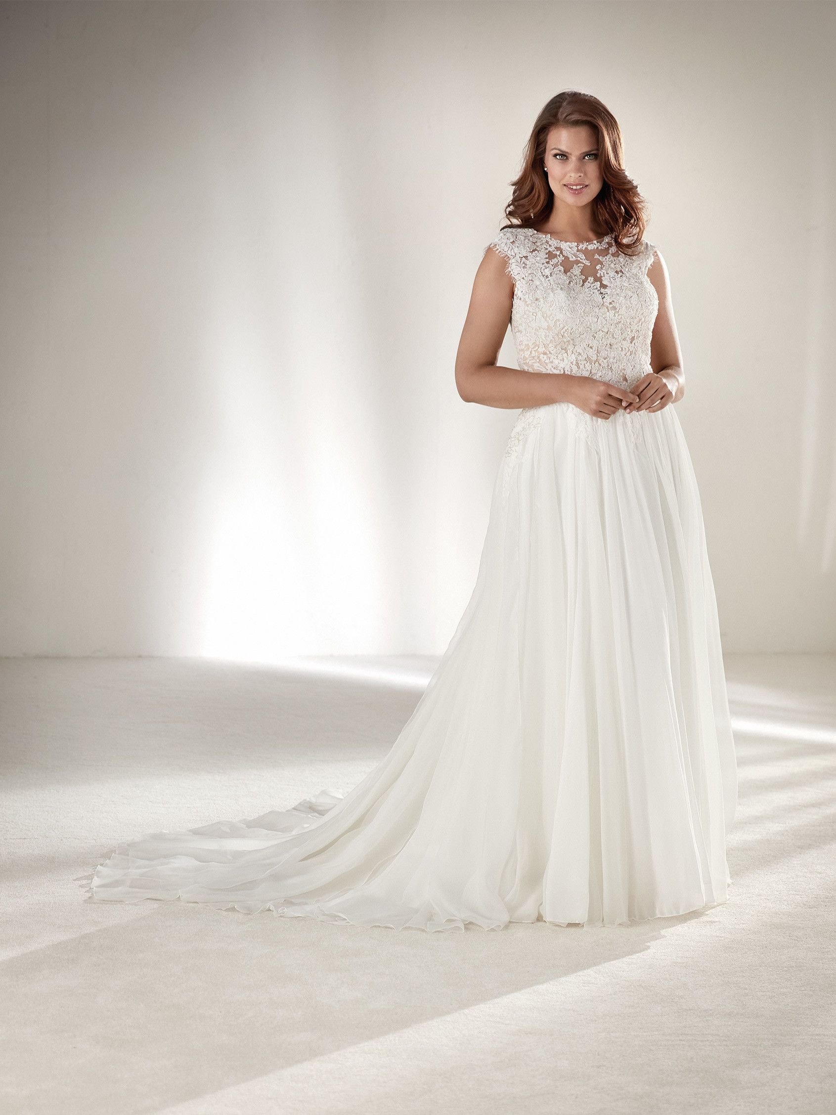 Plussize highnecked wedding dress pronovias collection