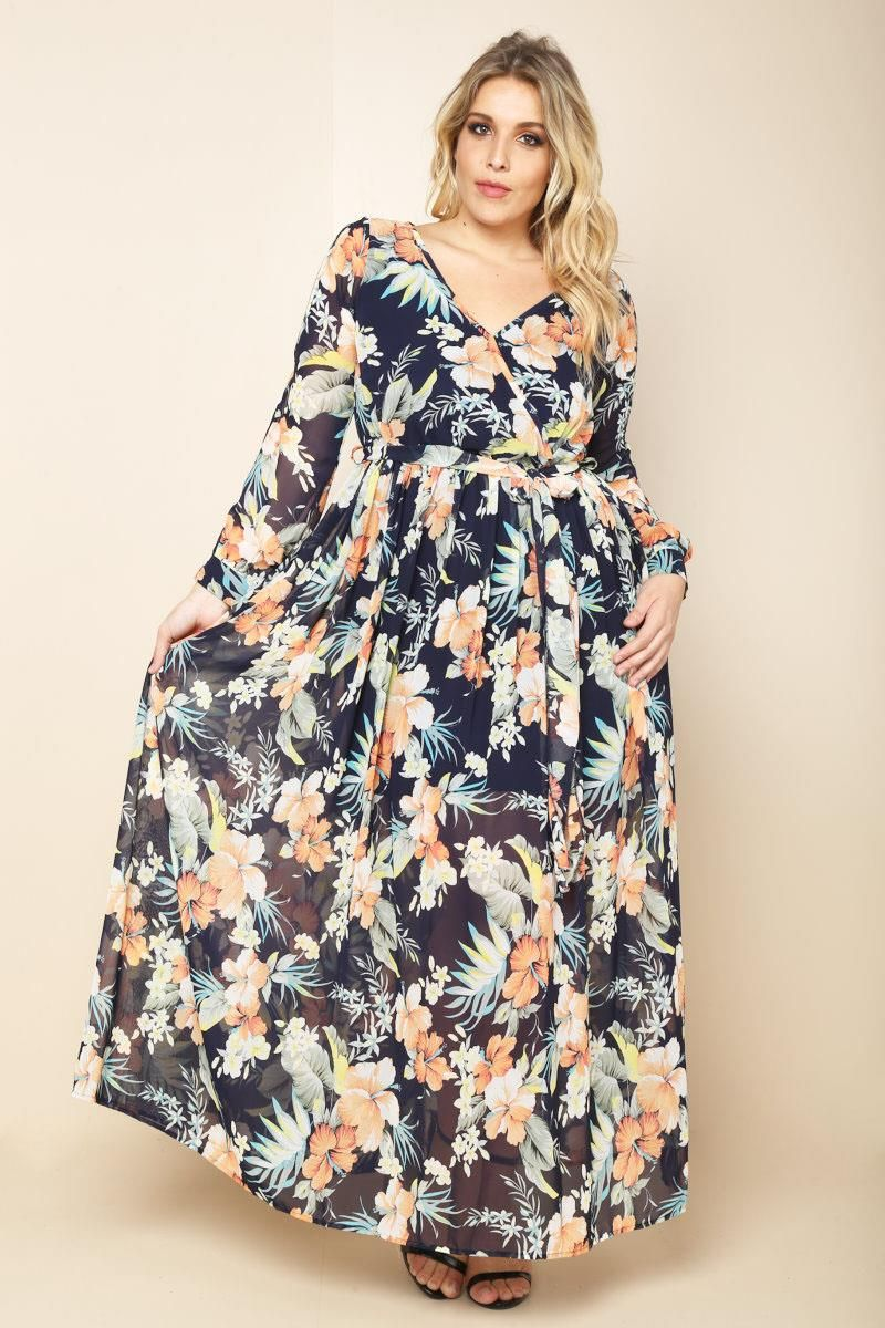 A plus size maxi dress with a wrapped vneckline and long sleeves