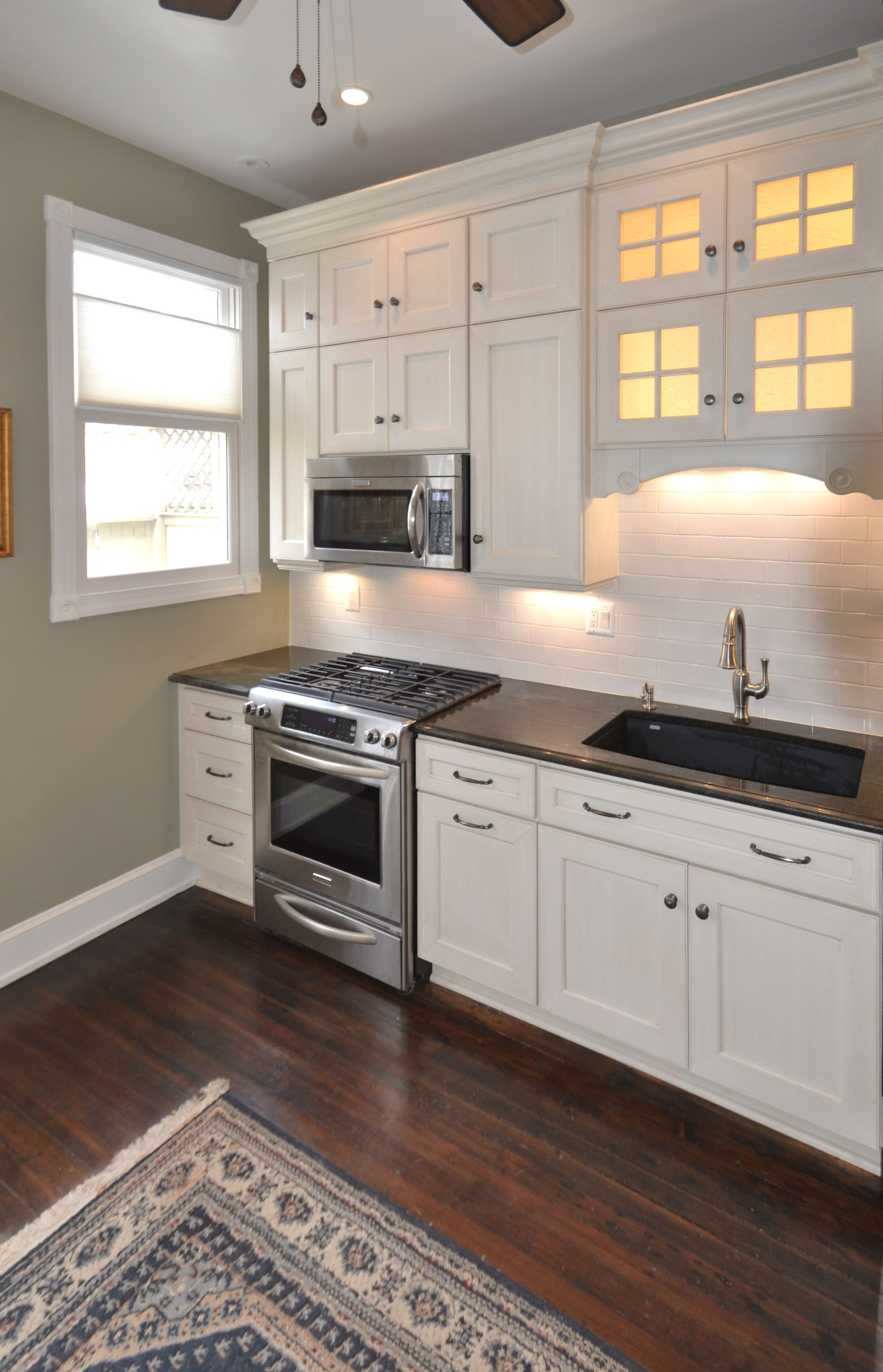 +100yo DC Townhome Renovation. Custom Cabinets Feature A Brushed Finish.  Nice! The