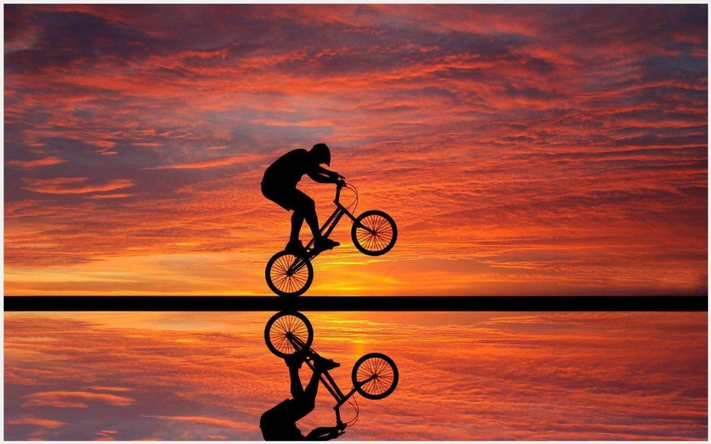 Cycle Stunt On Sunset Beach Wallpaper Cycle Stunt On Sunset Beach