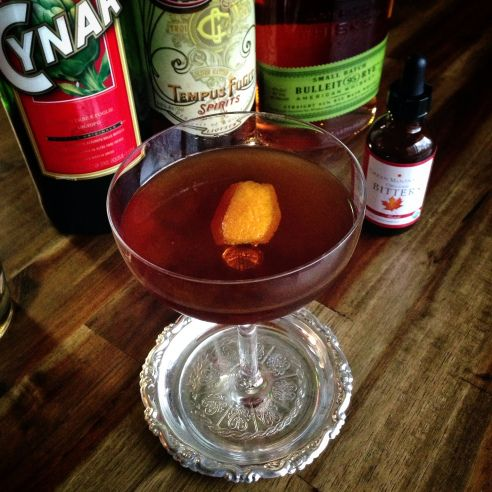 Eloquent Gentleman 1oz Rye  1oz Gran Classico  1oz Cynar  Peaty Scotch (rinse)  Dash Urban Moonshine Maple bitters  Flamed Orange Twist