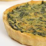 Greek Spinach Casserole ~ OK, I plugged this in to myfitnesspal.com's recipe database... WITH a Pillsbury refrigerated pie crust, the numbers look like this: Total Calories & Carbs: 1,795 142 Calories & Carbs/Serving: 299 24 WITHOUT the pie crust: Total Calories & Carbs: 1,075 54 Calories & Carbs/Serving: 179 9 I'll let you decide how you want to portion out your carb & calorie budget!
