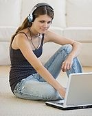 Girl looking at laptop - stock image