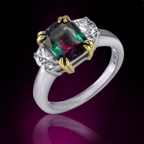 RM3796  Crafted in platinum this magnificent ring features a cushion cut 2.75 ct. natural alexandrite set by 18K yellow gold double prongs between two white half moon diamonds with a 0.70 ct. tw.  www.markhenryj.com