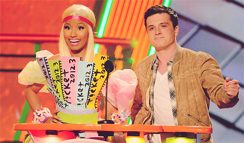 They would have him present with a Capitol Citizen. haha. Gotta love the Kids Choice Awards.