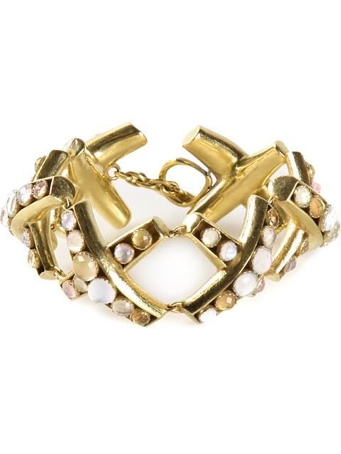 Gold round stone bracelet from Vaubel featuring x with stones, a toggle closure and is handmade.