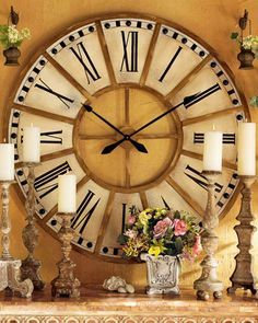 """Wall clock based on a design seen in a French train station. Hand-painted iron frame. 45""""Dia. x 1""""D. Uses one AA battery (not included). Boxed weight, approximately 35 lbs."""