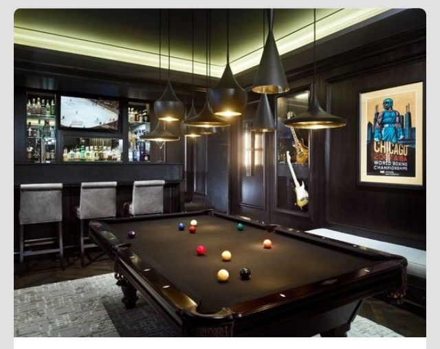 Panelled pool room with bar and cool wall art The dark wood floor