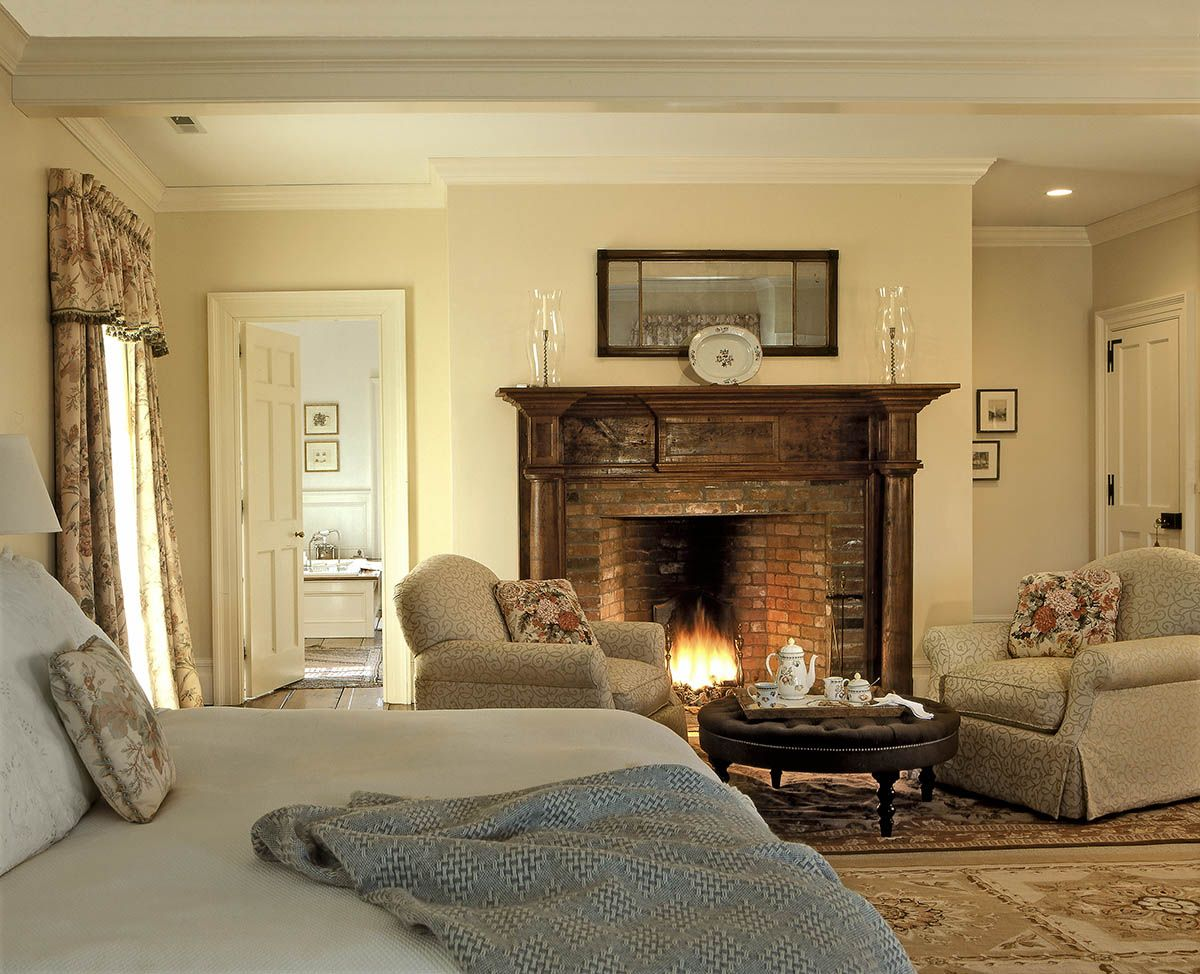 Master Bedroom with Wooden Fireplace Surround - Crisp Architects ...