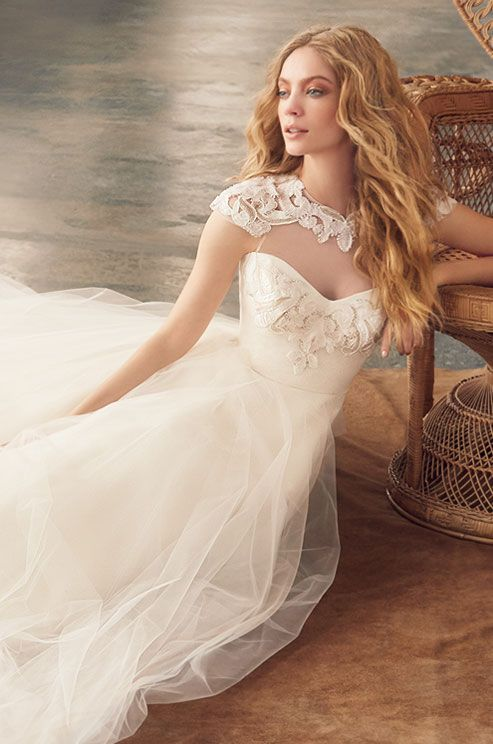 Ivory tulle bridal ball gown, textured floral sweetheart neckline and shoulder cap detail, layered tulle skirt with horsehair trim. Blush, Fall 2015