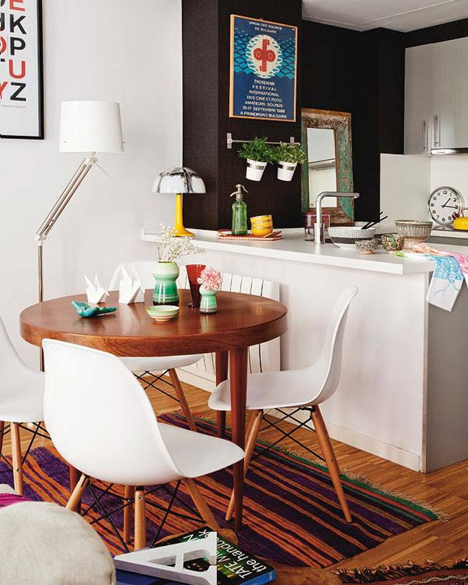 Nice Wooden Round Table Eames Chairs Colorful Carpet And Kitchen
