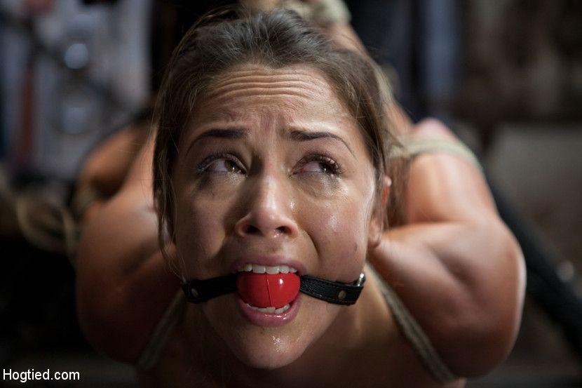 Girl cries during bondage