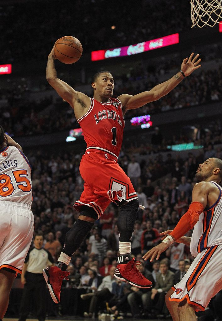 26700091f9c6 Derrick Rose  1 of the Chicago Bulls goes up for a dunk between Baron Davis   85 and Tyson Chandler  6 of the New York Knicks on his way to a game-high  32 ...