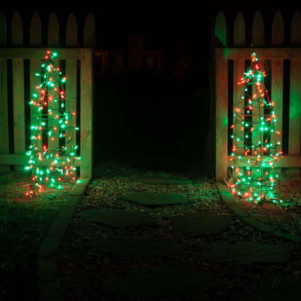 Tomato cage Christmas tree using red and green led string lights. - Outdoor Christmas Decorating Ideas Christmas Yard Ideas