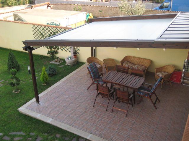 Beautiful Coprire Un Terrazzo Images - Idee Arredamento Casa ...