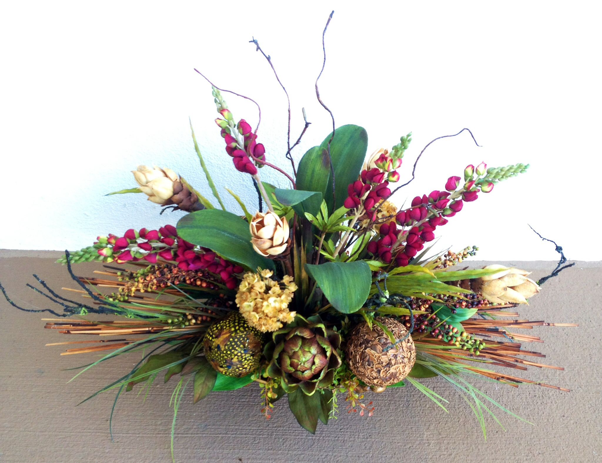 Feather Ball With Protea Flower Arrangement Designed By Arcadia Floral