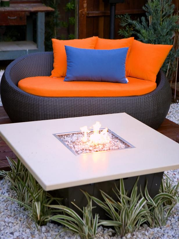 Fire Pit Design Ideas: If romance is your intention, make sure you've got a plush lounge sitting fireside.  From DIYnetwork.com-- <3 the chair!