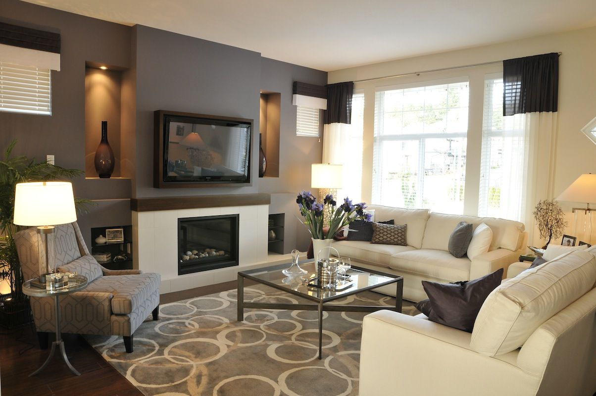 Modern living space with drak grey accent wall | Living Spaces ...