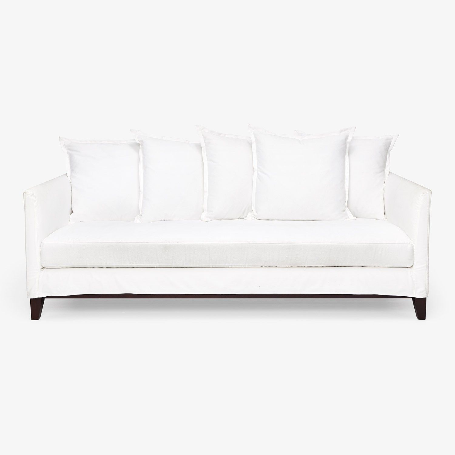 Exclusively at ABC, the Hampton sofa features a cool presence with a crisp, cotton slipcover and overstuffed pillows. Handcrafted from a Goodwood frame with richly stained legs, this clean-lined piece is simple sophistication meets sustainability.