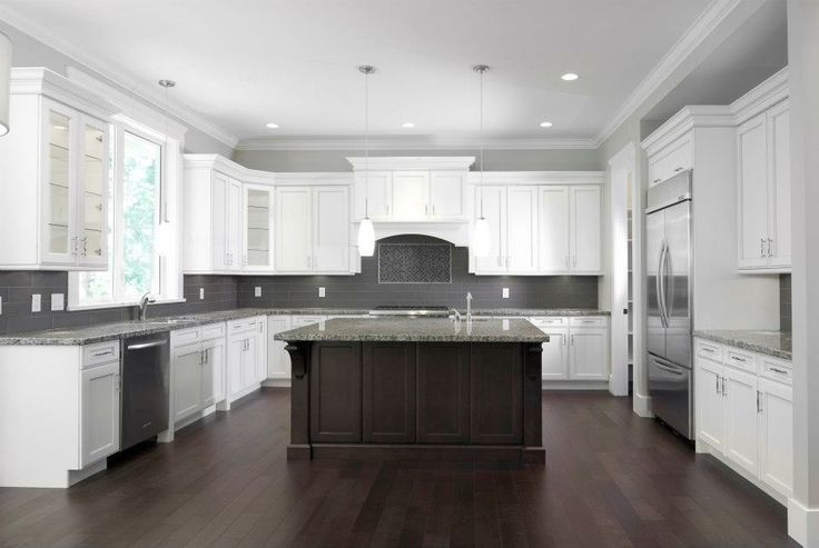 white cabinets grey glass backsplash dark island dark wood floor