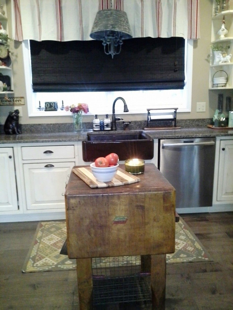 Kitchen natural rustic wooden butcher block island with white