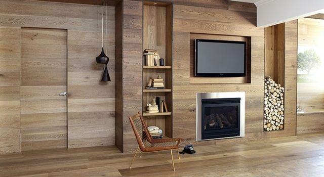 Salon élégant avec panneau mural bois cheminée à insert et