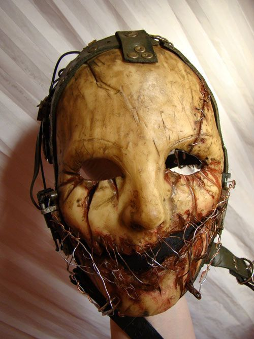 a collection of 33 terrifying halloween masks some of these are really interesting this one pictured is particularly neat