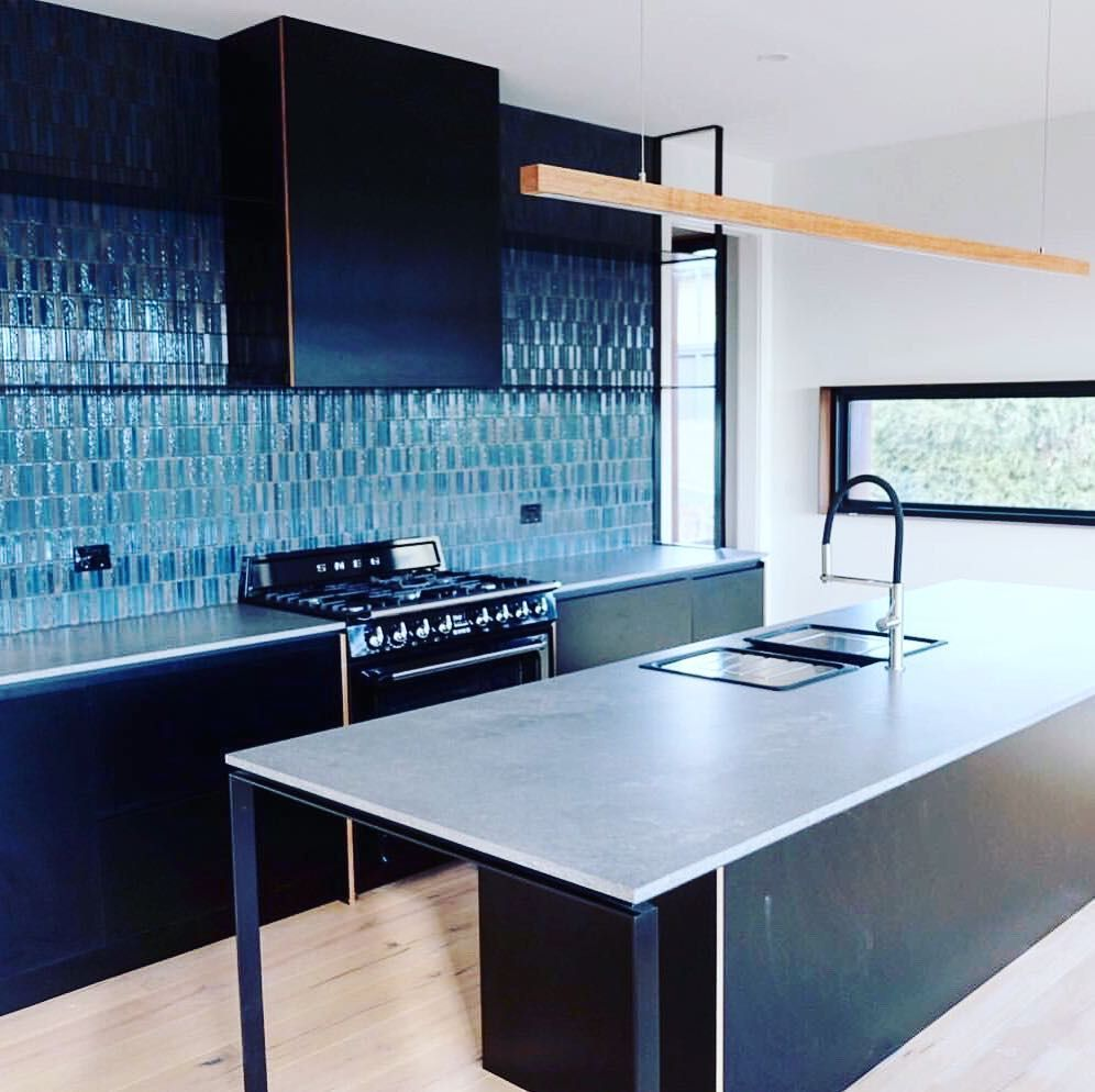 Our 2b5 linear timber pendant floating above this modern ...