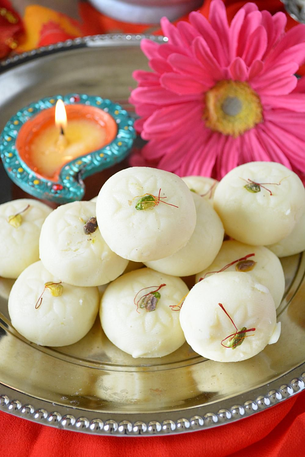 Milk Peda Recipe also known as doodh peda, is a favorite Indian sweet made with mawa (milk solids) & flavored with cardamom & nuts. It's so deliciously rich & creamy that it will melt in your mouth. #peda #diwali #diwalisweets #doodhpeda #indiansweets #milkpeda #milkfudge